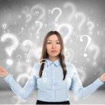 woman surrounded by question marks, symbolizing SEO questions