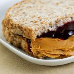 a bread with peanut butter and jelly, symbolizing the connected relationship between SEO and UX